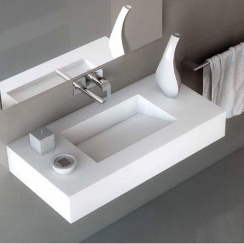 lavabo suspendido / rectangular / de cerámica / de Corian®