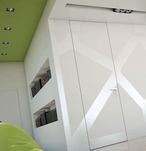 puerta de interior / abatible / de madera / suelo-techo