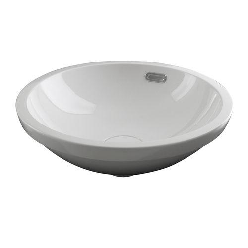 lavamanos integrado / redondo / de cerámica / para el sector servicios