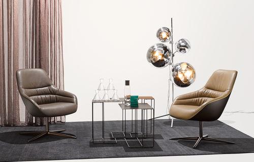 sillón contemporáneo / de cuero / con orejas / con patas en forma de estrella