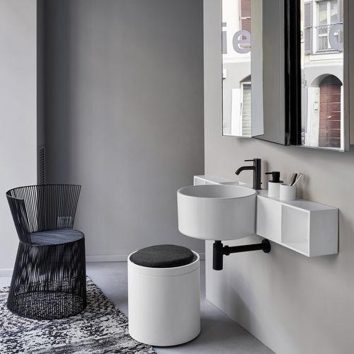 lavabo suspendido / redondo / de cerámica / contemporáneo