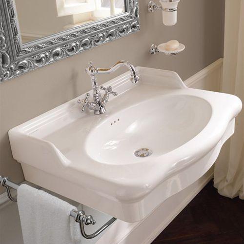 lavabo suspendido / ovalado / de cerámica / clásico