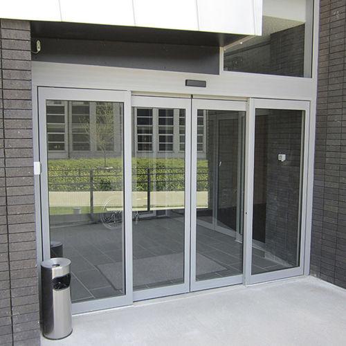 puerta de entrada / abatible / corredera / de vidrio