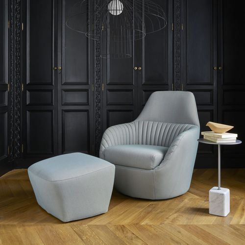 sillón contemporáneo / de cuero / con reposapiés / giratorio