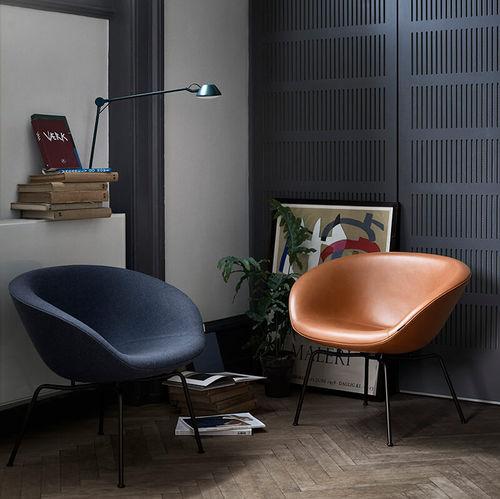sillón contemporáneo / de tejido / de cuero / de acero cromado