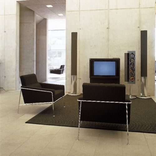 sillón de diseño escandinavo / de tejido / de cuero / de acero cromado