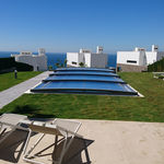cubierta para piscina baja / telescópica / de aluminio / con accionamiento manual