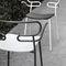 sillón de diseño original / de tejido repelente al agua / de metal lacado / de poliuretano