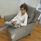 sillón contemporáneo / de tejido / de cuero / con reposapiés