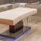 mesa de masaje fija / de madera / para el sector servicios