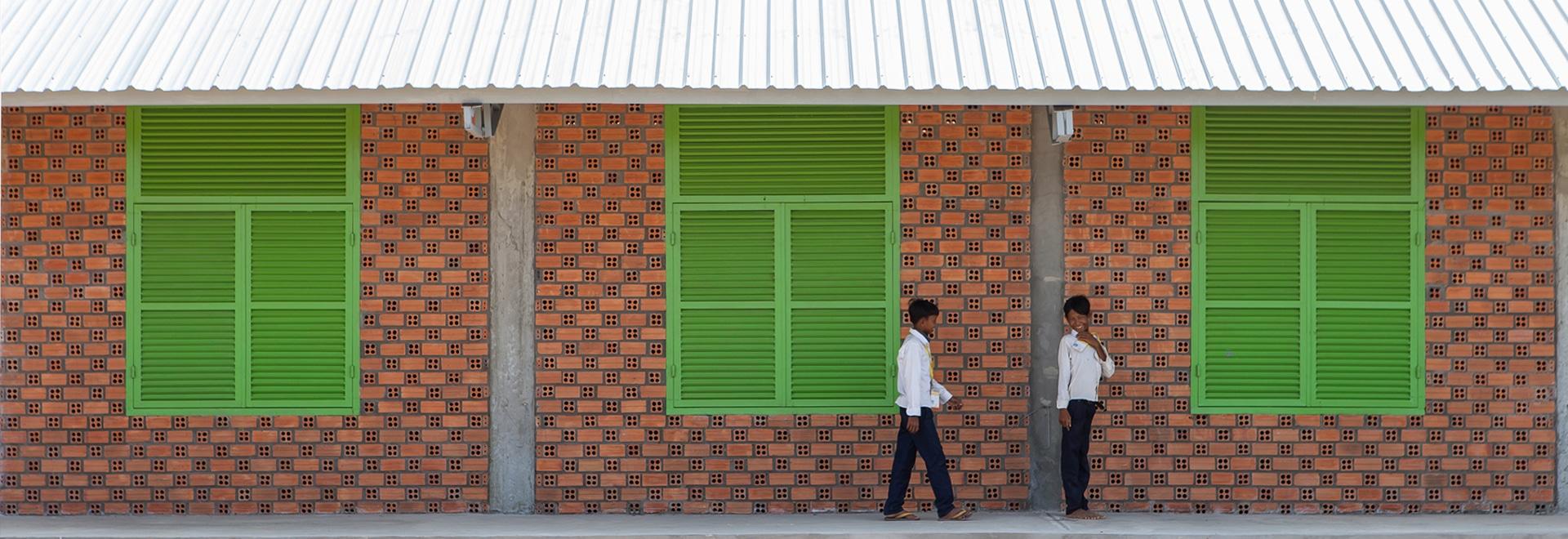 weston williamson + escuela ladrillo-revestida del diseño internacional de la confianza del socio y del edificio en Camboya