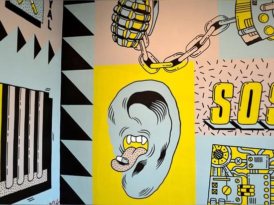 ¿las ilustraciones incluyen las letras? ¿SOS? y un mashup de una boca y de un oído que tragan una píldora