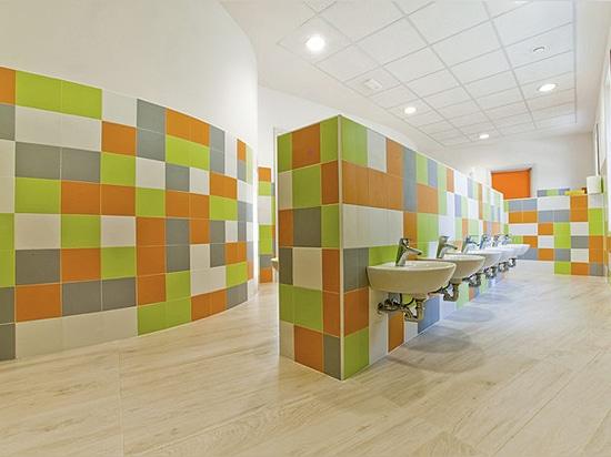 FAP ceramiche firma los baños del nuevo centro infantil de la empresa Gruppo Concorde
