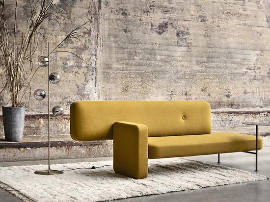 El guijarro es un sofá asimétrico que desafía la Convención
