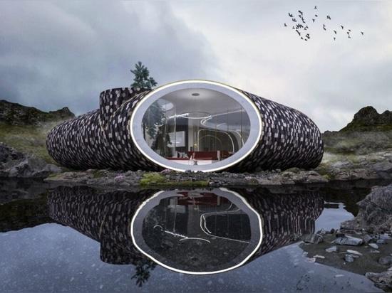 La casa futurista, inspirada en las conchas marinas, está revestida de madera recuperada