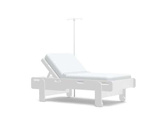 Loll Designs crea una cama de campo en un hospital de emergencia para ayudar a la pandemia