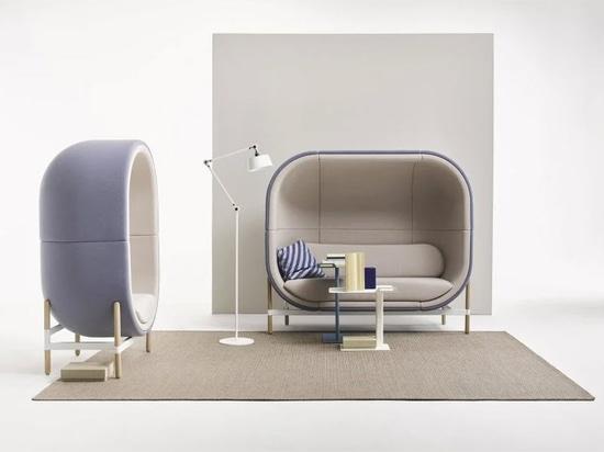 La silla de la cápsula absorbente del sonido imagina una nueva realidad de oficina post COVID-19