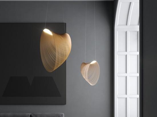 Un LED y una madera cortada con láser se combinan para crear este colgante de luz escultural